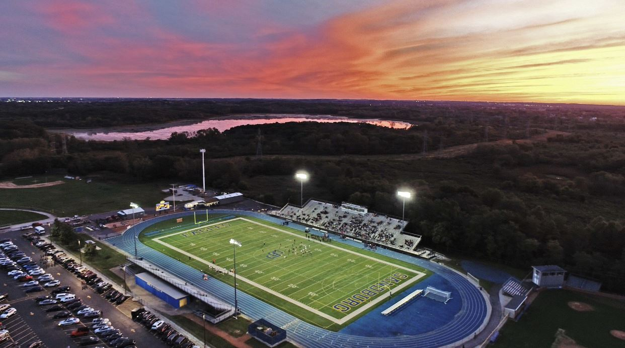 The sun setting on the Mike Navarro Stadium at Carl Sandburg High School